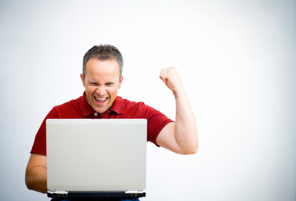 Excited Man Over Laptop